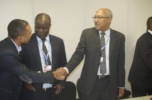 Chair of the African Group of Negotiators on Climate Change, Nagmeldin G. Elhassan (right), in a handshake with Samual Samson Ogallah of the Pan-African Climate Justice Alliance (PACJA)  Civil Society's visit to African Group at COP 20 in photos AG1 300x199