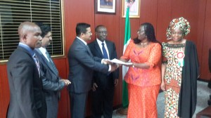 Minister of Lands, Housing & Urban Development, Akon Eyakenyi (second right), shaking hands with Anand Ramani (third left) of the Dubai-based Signature Value Homes. Minister of State, Federal Capital Territory (FCT) Development, Jumoke Akinjide (right); Permanent Secretary in the Lands, Housing & Urban Development Ministry, George Ossi, and other guests look on.  FG, UAE firm in $80 million Abuja housing initiative Housing pic 300x168