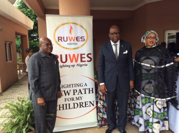 Sir John Odey (left), Mr Daouda Toure (middle) and Mrs Bahijjahtu Abubakar at a function last year: Climate change mitigation initiatives being undertaken by the Abuja-based RUWES Nigeria is helping to keep the earth's warming under 1-5-degree