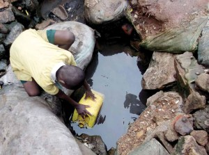 Children fetching unclean water  Beyond endurance: Pictures telling Uganda's water story Page26 300x223
