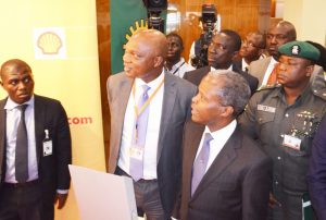 Managing Director of The Shell Petroleum Development Company of Nigeria Ltd and Country Chair, Shell Companies in Nigeria, Mr. Osagie Okunbor (2nd left), conducting Vice President Yemi Osinbajo round the Shell exhibition stand at the 21st Summit of the Nigeria Economic Summit in Abuja… on Tuesday, October 13, 2015
