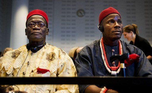 Two of the four Nigerian farmers (Chief Fidelis A. Oguru-Oruma (left) and Eric Dooh) sit in the law courts in The Hague on October 11, 2012. The four farmers take on Shell in a Dutch court, accusing the oil giant of destroying their livelihoods in a case that could set a precedent for global environmental responsibility. Photo credit: AFP / ANP / ROBIN UTRECHT  netherlands out  Rights groups hail Dutch court ruling, Shell winces Nigerian farmers suing Shell in Dutchland