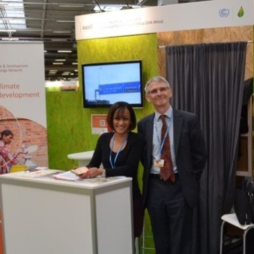 CDKN Chief Executive Sam Bickersteth and Head of Negotiations Support Kiran Sura welcome delegates to the CDKN stand in Paris. Photo credit: Geoff Barnard, CDKN  Opportunity, challenges ahead Paris Agreement, by CDKN cdkn stand at cop21 cropped 365x365