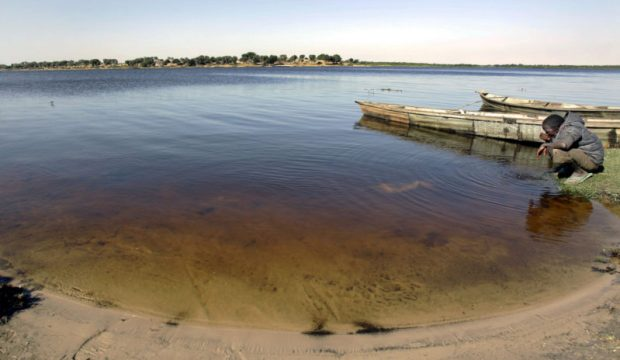 Scientists say the Lake Chad has shrunken by 95 percent over the past 50 years. Photo credit: AP/Christophe Ena  Buhari urges rich nations to save disappearing Lake Chad lake chad e1469143691116