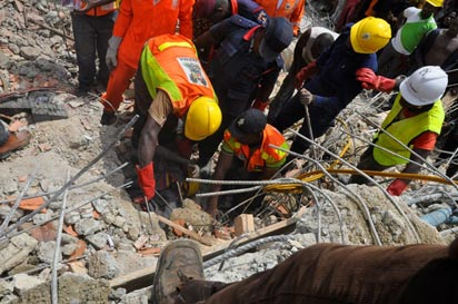 Rescue workers at the building collapse site  How government can end building collapse in Lagos Ikate Elegushi collapsed bu