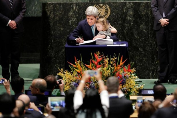 U.S. Secretary of State John Kerry holds his granddaughter Isabel Dobbs-Higginson as he signs the Paris Agreement on climate change, Friday, April 22, 2016  Americans, global warming, God and 'end times' Kerry e1461783857604