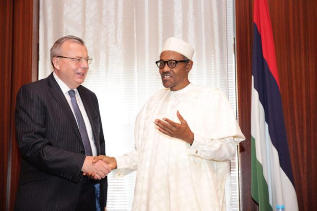 Executive Director of the UN Office on Drugs and Crime (UNODC), Yury Fedotov, with President Muhammadu Buhari