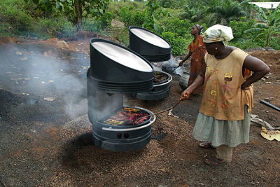 A solar grill stove in use by rural women