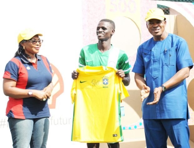L-R: General Manager, Portfolio Deepwater of The Shell Petroleum Development Company of Nigeria Limited, Mrs. Sophie Pokima; Football Captain of the Federal College of Education (Technical) Akoka, Lagos, Master Toyin Gbolahan; and the Provost of the College, Dr. Siji Olusanya, presenting a Pele-autographed Brazil Jersey to the captain after the Pele Power The Field Challenge in Lagos... on Thursday.  Pelé unveils player-powered energy challenge MTF 1 e1467382333451