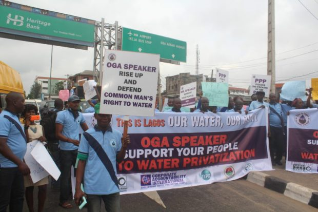 The protest march saw activists march through the streets, handing out leaflets and singing solidarity songs   Water privatisation isn't way out, crusaders urge Lagos lawmakers Rally e1469704392483