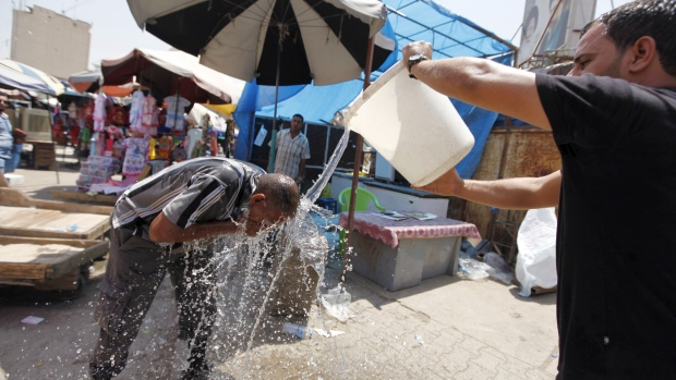A man cools off amid the searing heat wave   Refugees groan under Middle East heatwaves heatwave