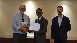 Environment Expert, United Nations Industrial Development Organisation (UNIDO) Regional Office in Abuja, Mr Oluyomi Banjo (middle) receiving a certificate at the close of the training