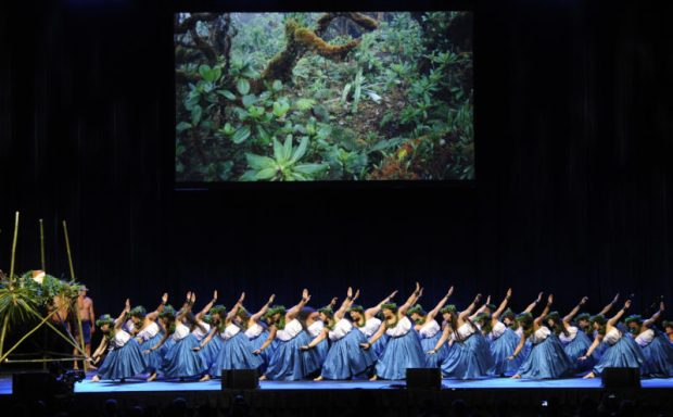 Dancers of Nakinimakalehua Consortium (with Halau Ke'alaokamaile, Pa'u O Hi'iaka, Halau Kamaluokaleihulu and Halau Hi'iakainamakalehua) take the stage during the closing performances in the IUCN World Conservation Congress opening ceremony, Neal S. Blaisdell Centre arena in Hawai'i, Thursday, September 1, 2016. Photo credit:  CTY - HSA / Bruce Asato