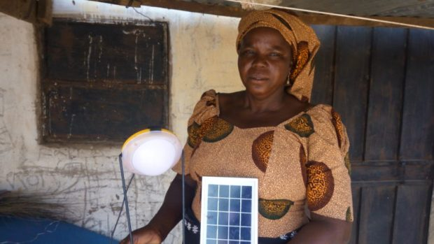 """Mrs Alpha Williams, farmer and business woman: """"I now save a lot of money from constant purchase of batteries to power torchlights and kerosene for lanterns. Also, at night, my children read and do their homework with the solar lamp, which I at the same time use to charge my phone. Everything is so convenient and life is now so much easier for us. We also don't need to go far to fetch water. As you can see, the water station is just by my doorstep. We say thank you to the UNDP and ECN for this kind and timely gesture."""""""