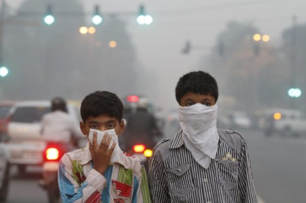 Children exposed to air pollution  300 million children breathe toxic air, says UNICEF air pollution e1478055136179