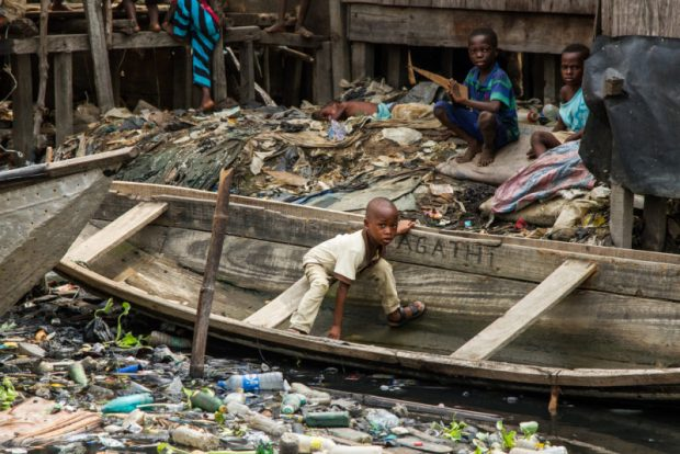 Littered wetland  Lagos: The cost of urbanisation A littered wetland e1509668592908