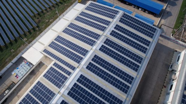 Solar panels  Group launches online tool to assess economics of solar investments Solar roof on industrial building smaller e1522459136213
