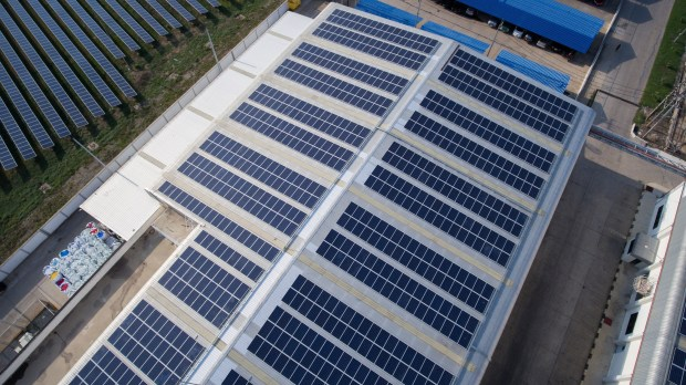 Solar panels  Top EU court backs Germany on renewable energy surcharge rebates Solar roof on industrial building smaller 1024x575