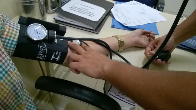 Nurse measuring heart rate