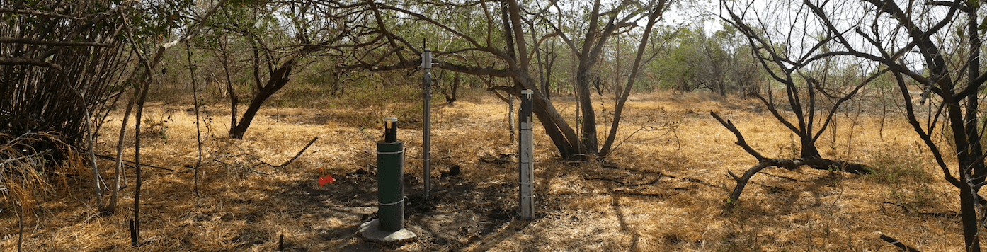 Example of a typical monitoring station: Surface and sub-surface water elevation and EC monitoring wells, and soil moisture and EC at 30 and 60 cm depths. Sensors connected to wireless cellular data logger for near real-time data access. Photo taken during the dry season.  Photo credit: Alice Alonso