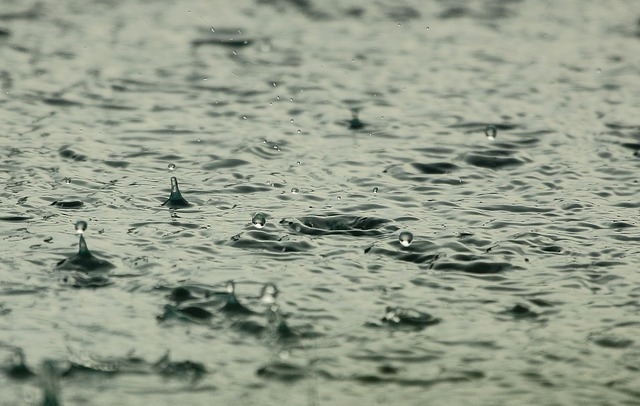 Water droplets falling onto a larger body of water