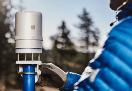 Image of METER researcher adjusting an ATMOS 41 weather station
