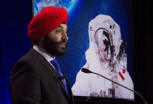 "Innovation minister Bains announcing an open call for two new astronauts at the Canadian Aviation and Space Museum on Friday, June 17th. As outlined in the June 17th, 2016 Canadian Press article, ""Canadian Space Agency seeks polite astronauts to join space program,"" applications for two new astronaut openings are being accepted until Aug. 15th, and ""the more stereotypically Canadian the astronaut-hopefuls are, the better."" For a more formal perspective on the application process, check out the CSA web page on astronaut recruitment. Photo c/o Adrian Wyld / Canadian Press."