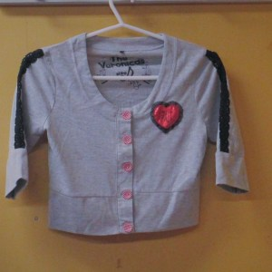 girls pre loved top by the veronicas in excellent condition