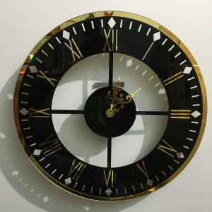 Wall clock in rounded black golden for home and office