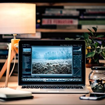 Photoshop image editing on tidy desk