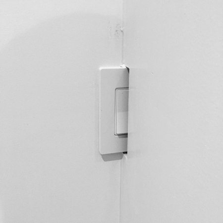 Light switch stuck behind wall, bad UX