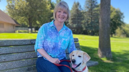 Former Eden Prairie City Clerk Kitty Porta poses for a photo with her dog Max.