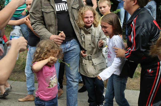 MALONNE, BELGIUM - SEPTEMBER 01: Little children cry because of pepper spray during a protest against the early release of Michelle Martin, ex wife of child murderer Marc Dutroux, who stays at the Clarisse Monastry on September 1, 2012 in Malonne, Belgium. Michelle Martin was jailed in 2004 for 30 years for being an accomplice to the murders and kidnapping of 6 girls by Marc Dutroux, but is being released after a Belgian court ruling. (Photo by Mark Renders/Getty Images)