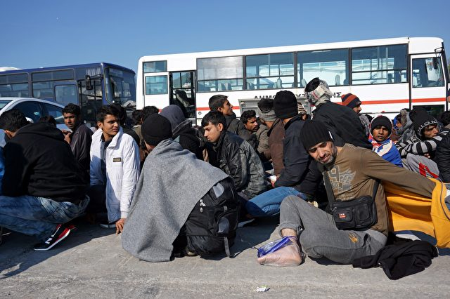 Migrants and refugees wait to board buses taking them to the registration hotspot of Moria, from the port of Mytilene on the Greek island of Lesbos on March 29, 2016, after they were rescued by Frontex and Greek coast guards. The United States will provide an additional $20 million (18 million euros) in aid for refugees in Europe, a senior US official said on March 28, 2016. Most of the funds -- $17.5 million -- will be given to the UN refugee agency, Higginbottom said during a visit to Lesbos, the island that has experienced most of the refugee arrivals registered in Greece since 2015, where there are over 2000 refugees and migrants according to the Greek government. / AFP / - (Photo credit should read -/AFP/Getty Images)