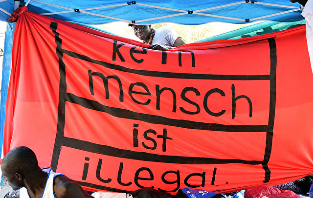 Flüchtlinge und Migranten demonstrieren in München. 13. September 2016. Foto: Joerg Koch/Getty Images