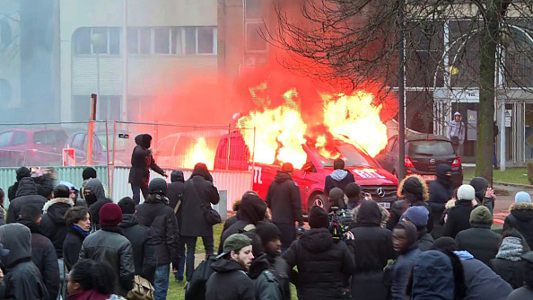 An image grab taken from an AFP video shows a van of French radio station RTL burning during clashes on the edge of a rally to denounce police brutality after a black man was allegedly sodomised with a baton during an arrest while in their custody in Paris on February 11, 2017 in Bobigny, outside Paris. A 22-year-old black youth worker named as Theo, a talented footballer with no criminal record, required surgery after his arrest on February 2, 2017 when he claims a police officer sodomized him with his baton. One officer has been charged with rape and three others with assault over the incident in the tough northeastern suburb of Aulnay-sous-Bois which has revived past controversies over alleged police brutality. / AFP / Grégoire OZAN        (Photo credit should read GREGOIRE OZAN/AFP/Getty Images)