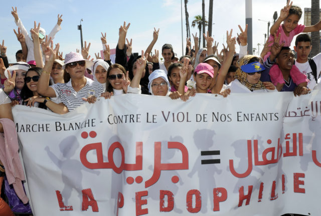 Moroccans gather during a demonstration against child sexual abuse in Casablanca on May 5, 2013, after a harrowing assault last month left a nine-year-old girl near-dead. Last month the child Wiam was found unconscious in a pool of blood by her 6-year-old brother after a neighbour in a village of the Sidi Kacem region in northwest Morocco sexually abused her and beat her up, media reports said. AFP PHOTOS/FADEL SENNA        (Photo credit should read FADEL SENNA/AFP/Getty Images)