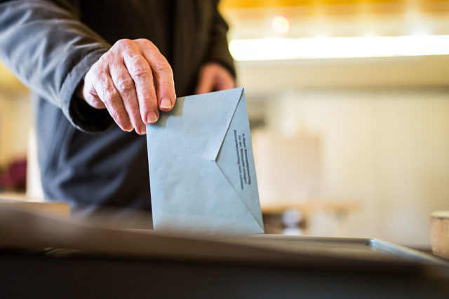 TRIER, GERMANY - MARCH 13:  An elector casts his ballot in Rhineland-Palatinate state elections on March 13, 2016 in Trier, Germany. State elections taking place today in three German states: Rhineland-Palatinate, Saxony-Anhalt and Baden-Wuerttemberg, are a crucial test-case for German Chancellor and Chairwoman of the German Christian Democrats (CDU) Angela Merkel, who has come under increasing pressure over her liberal immigration policy towards migrants and refugees. The populist Alternative fuer Deutschland (Alternative for Germany, AfD), with campaign rhetoric aimed at Germans who are uneasy with so many newcomers, has solid polling numbers and will almost certainly win seats in all three state parliaments.  (Photo by Simon Hofmann/Getty Images)
