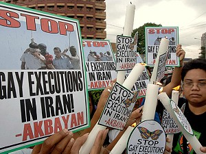 Демонстранты в Маниле, Филиппины, протестуют против смертной казни двух подростков в Иране из-за того, что они были гомосексуалистами. Фото: Jay Directo /AFP /Getty Images