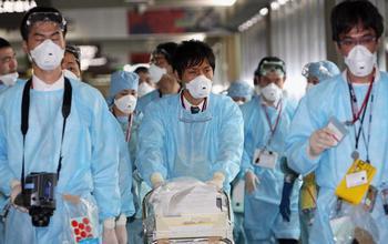 ВОЗ: от свиного гриппа в мире умерло уже 2185 человек. Фото: Junko Kimura/Getty Images