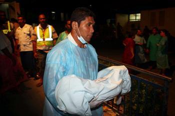 Жертвы цунами. Фото: Phil Walter/Getty Images