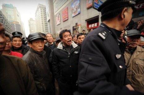 КНР  вновь подавляет запланированные протесты. Фото: Peter PARKS/ Getty Images