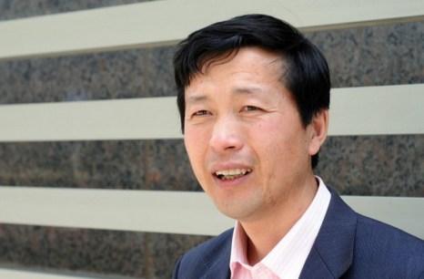 Китайский адвокат по правам человека Тан Цзитянь, Пекин, 29 апреля 2010 года. Он сообщал Epoch Times о новой кампании промывания мозгов в начале этого года. 16 октября он был задержан после попытки договориться китайскими властями об освобождении последователя Фалуньгун. Фото: Olli Geibel/AFP/Getty Images