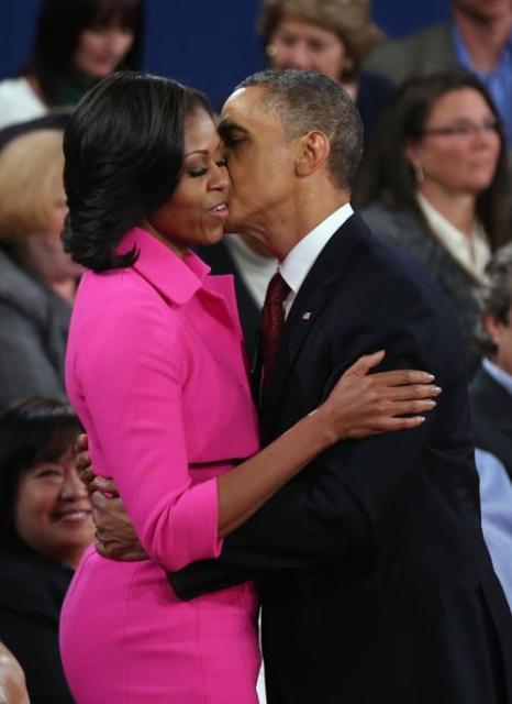 Президент США Барак Обама с женой Мишель Обама 16 октября 2012 в Hempstead, Нью-Йорк. Фото: Bruce Bennett/Getty Images