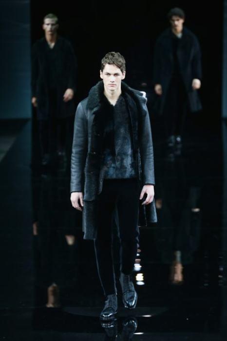 Знаменитый итальянский модельер Джорджио Армани представил новую молодёжную коллекцию мужской одежды Emporio Armani осень-зима 2014 на третий день миланской Недели моды, 13 января. Фото: Vittorio Zunino Celotto/Getty Images