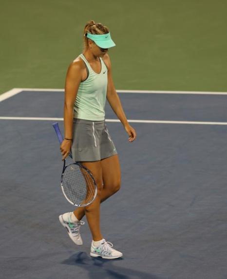Мария Шарапова после 6-недельного перерыва вылетела из турнира в американском Цинциннати, уступив победу американке Слоан Стивенс 13 августа 2013 года. Фото: Ronald Martinez/Getty Images