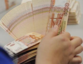 Денежные купюры. Фото РИА Новости