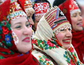 Масленичная неделя по Руси идет, блины, масло и мед несет. Фото: MARTIN BUREAU/AFP/Getty Images