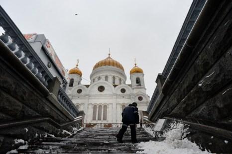 Погода в  Москве. Фоторепортаж. Фото: NATALIA KOLESNIKOVA/AFP/Getty Images