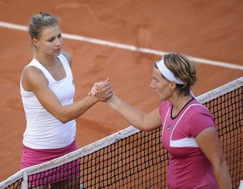 Светлана Кузнецова (R) и Мария Кириленко (L). Фото: Bertrand GUAY/AFP/Getty Images